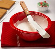 Red bowl of icing with spatula.jpg